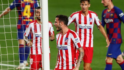 <p>               Atletico Madrid's Saul, center, celebrates after scoring his side's second goal during the Spanish La Liga soccer match between FC Barcelona and Atletico Madrid at the Camp Nou stadium in Barcelona, Spain, Tuesday, June 30, 2020. (AP Photo/Joan Monfort)             </p>