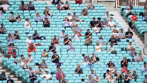 <p>               Spectators observe social distancing in the stands during the friendly cricket match at the Oval, London, Sunday, July 26, 2020. Spectators have been allowed into a sporting event in England for the first time since March when coronavirus prevention measures were tested at a cricket match between Surrey and Middlesex at The Oval ahead of a planned wider reopening of stadiums in October. Alternate rows were used across two stands and advisory signs were on show for the friendly match being watched by 1,000 people. (John Walton/PA via AP)             </p>
