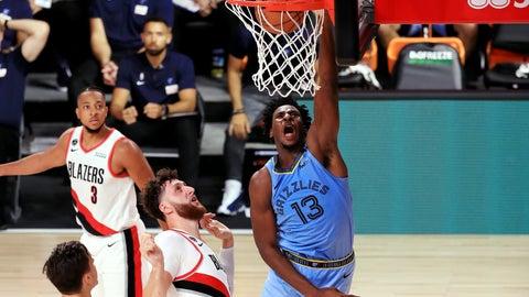<p>               Memphis Grizzlies' Jaren Jackson Jr. dunks the ball during the second half  of an NBA basketball game against the Memphis Grizzlies against the Portland Trail Blazers, Friday, July 31, 2020, in Lake Buena Vista, Fla. (Mike Ehrmann/Pool Photo via AP)             </p>