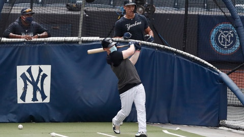 <p>               New York Yankees hitting coach Marcus Thames, left, and Aaron Judge, right, watch Clint Frazier bat in the cage during a summer training camp workout, Wednesday, July 8, 2020, at Yankee Stadium in New York. (AP Photo/Kathy Willens)             </p>