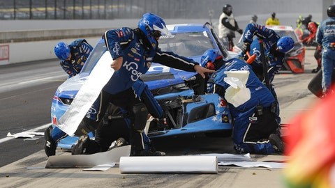 <p>               Crew members for the car driven by Ricky Stenhouse Jr. work on the car after a crash in the pit area during a NASCAR Cup Series auto race at Indianapolis Motor Speedway in Indianapolis, Sunday, July 5, 2020. (AP Photo/Darron Cummings)             </p>