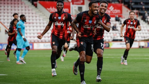 <p>               Bournemouth's Callum Wilson, center, celebrates his goal before it was disallowed by VAR during the English Premier League soccer match between Bournemouth and Tottenham at the Vitality Stadium in Bournemouth, England, Thursday, July 9, 2020. (AP photo/Matt Dunham, Pool)             </p>