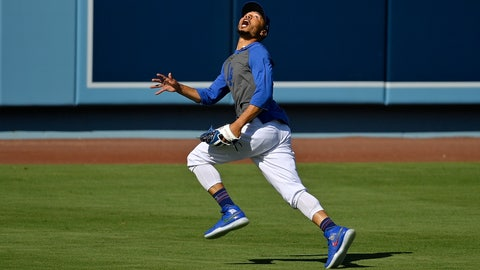 <p>               Los Angeles Dodgers right fielder Mookie Betts fields a fly ball during the restart of baseball spring training Sunday, July 5, 2020, in Los Angeles. (AP Photo/Mark J. Terrill)             </p>