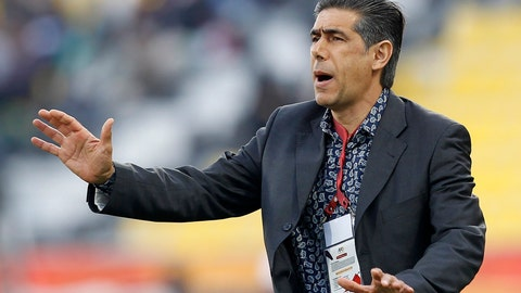 <p>               FILE - In this Jan. 15, 2011, file photo, Iran's team coach Afshin Ghotbi reacts against North Korea during their AFC Asian Cup group D soccer match in Doha, Qatar. An eight-month wait for the new Chinese Super League to start is nearly over, a delay nearly as long as it takes to play a regular season. And July 25 can't come soon enough for the players and coaches. (AP Photo/Hassan Ammar, File)             </p>
