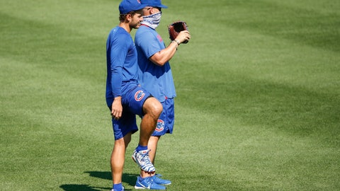 <p>               Chicago Cubs first baseman Anthony Rizzo, left, stands next to manager David Ross, right, during baseball practice at Wrigley Field, Sunday, July 5, 2020, in Chicago. (AP Photo/Kamil Krzaczynski)             </p>