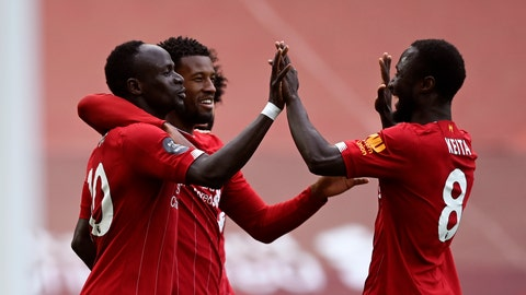 <p>               Liverpool's Sadio Mane, left, celebrates after scoring the opening goal during the English Premier League soccer match between Liverpool and Aston Villa at Anfield Stadium in Liverpool, England, Sunday, July 5, 2020. (Shaun Botterill/Pool via AP)             </p>