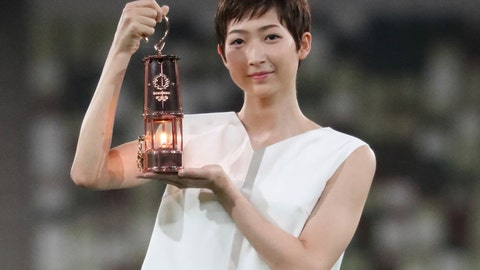 <p>               FILE - In this July 23, 2020, file photo, Japanese swimming athlete Rikako Ikee holding the lantern containing Olympic flame poses during a photo session at the Olympic Stadium in Tokyo. Friday, July 31, would have been the seventh full day of the postponed Tokyo 2020 Olympics; almost the halfway point. The focus is now entirely on how to pull off the games next year, in what still might be the middle of a pandemic. (Du Xiaoyi/Pool Photo via AP, File)             </p>