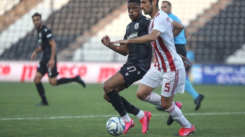 <p>               PAOK's Chuba Akpom challenges Olympiakos' Andreas Bouchalakis, foreground right, during their Super League soccer match, in Thessaloniki, northern Greece, Sunday, June 7, 2020. The Greek Super League returned to action this weekend, following almost three months of inactivity due to measures against the coronavirus pandemic. (AP Photo/Giannis Papanikos)             </p>