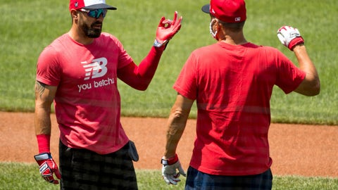 <p>               Washington Nationals' Adam Eaton (2), left, speaks with a staff member as the Washington Nationals hold their first training camp work out at Nationals Stadium, Friday, July 3, 2020, in Washington. (AP Photo/Andrew Harnik)             </p>
