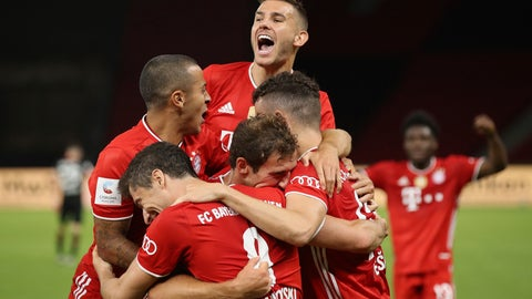 <p>               Munich's Robert Lewandowski , center bottom, celebrates with teammates after scoring his team's fourth goal during the DFB Cup final match between Bayer 04 Leverkusen and FC Bayern Muenchen at Olympiastadion in Berlin, Germany, Saturday, July 4, 2020. (Photo by Alexander Hassenstein/Pool via AP)             </p>