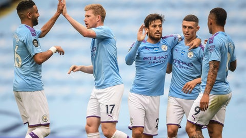 <p>               Manchester City players celebrate after scoring their second goal during the English Premier League soccer match between Manchester City and Newcastle at the Ethiad Stadium in Manchester, England, Wednesday, July 8, 2020. (Michael Regan/Pool via AP)             </p>