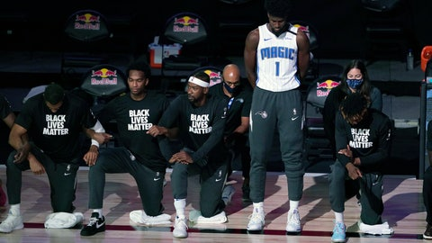 <p>               Orlando Magic's Jonathan Isaac (1) stands as others kneel before the start of an NBA basketball game between the Brooklyn Nets and the Orlando Magic Friday, July 31, 2020, in Lake Buena Vista, Fla. (AP Photo/Ashley Landis, Pool)             </p>