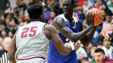 <p>               FILE - In this Jan. 19, 2020, file photo, Hillcrest Prep's Makur Maker (20) controls the ball against Sunrise Christian Academy during a high school basketball game at the Hoophall Classic in Springfield, Mass. Highly touted prospect Maker picked Howard University over UCLA, Kentucky and Memphis. The five-star recruit is the highest-ranked player to commit to a Historically Black College or University since ESPN began tracking such things in 2007. Maker is a 6-foot-11 center who declared for the NBA draft in April before opting to consider college basketball. (AP Photo/Gregory Payan, File)             </p>