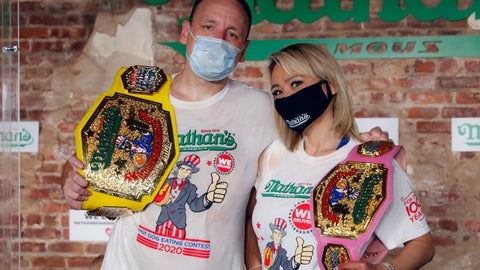 <p>               Competitive eaters Joey Chestnut, left, and Miki Sudo, right, pose for a photograph after winning their respective divisions with new world records after the Nathan's Famous July Fourth hot dog eating contest, Saturday, July 4, 2020, in the Brooklyn borough of New York. AP Photo/John Minchillo)             </p>