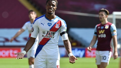 <p>               Crystal Palace's Wilfried Zaha reacts during the English Premier League soccer match between Aston Villa and Crystal Palace at Villa Park in Birmingham, England, Sunday, July 12, 2020. (AP Photo/Rui Viera, Pool)             </p>