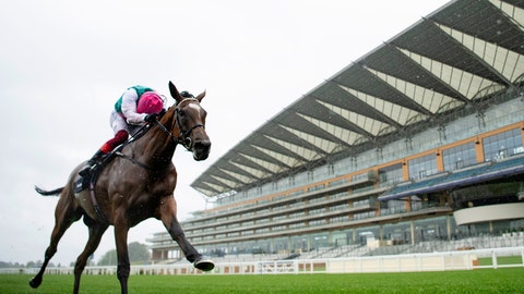 <p>               Enable ridden by jockey Frankie Dettori wins the King George VI and Queen Elizabeth QIPCO Stakes at Ascot Racecourse, England, Saturday July 25, 2020. (Edward Whitaker/PA via AP)             </p>