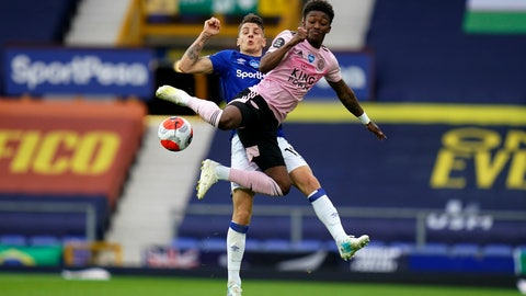 <p>               Leicester's Demarai Gray, foreground, and Everton's Lucas Digne fight for the ball during the English Premier League soccer match between Everton and Leicester at Goodison Park in Liverpool, England, Wednesday, July 1, 2020. (AP Photo/Jon Super, Pool)             </p>
