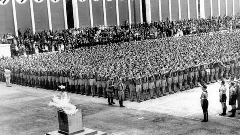<p>               FILE - In this Aug. 1, 1936, file photo, German Nazi soldiers line up at attention during the opening ceremonies of the XI Summer Olympic Games at the Lustgarten in Berlin, Germany. The lighted Olympic torch is in the foreground. The torch relay was not always a fixture of the modern Olympics, which began in 1896. The relay tradition began with Adolph Hitler's 1936 Olympics in Berlin, the Games of the XI Olympiad, and was the brainchild of Dr. Carl Diem who was the head of the organizing committee. (AP Photo/File)             </p>