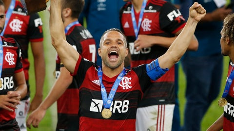 <p>               Soccer player Diego of Flamengo celebrates with the trophy after winning the Rio de Janeiro state championship at the Maracana stadium, Rio de Janeiro, Brazil, Wednesday, July 15, 2020. (AP Photo/Leo Correa)             </p>