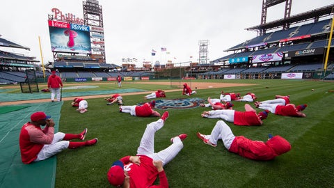 <p>               FILE - In this April 7, 2017, file photo, members of the Philadelphia Phillies stretch before the team's baseball game against the Washington Nationals in Philadelphia. Five players for the Philadelphia Phillies have tested positive for COVID-19 at the team's spring camp in Florida, prompting the club to indefinitely close the complex. The team also said Friday, June 19, 2020, that three staff members at the camp have tested positive. The club didn't identify any of those affected. (AP Photo/Matt Rourke, File)             </p>