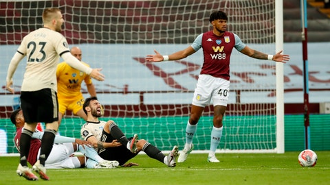 <p>               Manchester United's Bruno Fernandes reacts as he is fouled in the penalty box during the English Premier League soccer match between Aston Villa and Manchester United at Villa Park in Birmingham, England, Thursday, July 9, 2020. (AP PhotoAndrew Boyers,Pool)             </p>