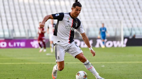 <p>               Juventus' Cristiano Ronaldo goes for the ball during the Serie A soccer match between Juventus and Torino, at the Allianz Stadium in Turin, Italy, Saturday, July 4, 2020. Juventus goalkeeper Gianluigi Buffon set an outright Serie A record on Saturday with his 648th appearance in Italy's top flight. The Turin derby game against Torino moved the 42-year-old Buffon one ahead of AC Milan great Paolo Maldini, who set the record in 2009. (Marco Alpozzi/LaPresse via AP)             </p>