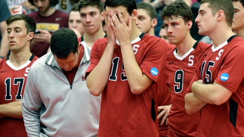 <p>               FILE - In this May 3, 2014, file photo, Stanford men's volleyball head coach John Kosty, second from left, looks down as players react after a 3-1 loss to Loyola in the NCAA men's college volleyball championship at Gentile Arena in Chicago. Stanford announced Wednesday, July 8, 2020,  that it is dropping 11 sports amid financial difficulties caused by the coronavirus pandemic. The school will discontinue men's and women's fencing, field hockey, lightweight rowing, men's rowing, co-ed and women's sailing, squash, synchronized swimming, men's volleyball and wrestling after the 2020-21 academic year. Stanford also is eliminating 20 support staff positions. (AP Photo/Nam Y. Huh, File)             </p>