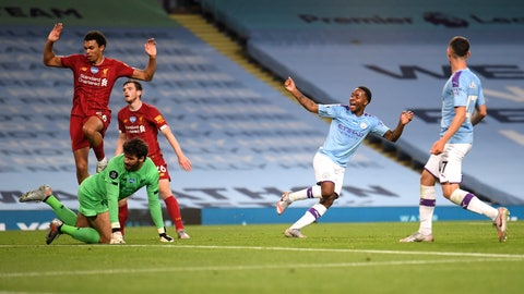 <p>               Manchester City's Raheem Sterling, second right, celebrates after his team's fourth goal during the English Premier League soccer match between Manchester City and Liverpool at Etihad Stadium in Manchester, England, Thursday, July 2, 2020. (AP Photo/Laurence Griffiths,Pool)             </p>