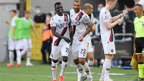 <p>               Bologna's Musa Juwara, left, celebrates with his teammate Danilo after scoring his side's 2nd goal during the Serie A soccer match between Inter Milan and Bologna, at the San Siro Stadium in Milan, Italy, Sunday, July 5, 2020. (Fabio Ferrari/LaPresse via AP)             </p>