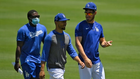 <p>               Los Angeles Dodgers right fielder Mookie Betts, center, and center fielder Cody Bellinger, right, chat during the restart of baseball spring training Saturday, July 4, 2020, in Los Angeles. (AP Photo/Mark J. Terrill)             </p>