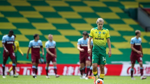 <p>               Norwich City's Todd Cantwell is dejected after West Ham scored their fourth goal during the English Premier League soccer match between Norwich City and West Ham at the Carrow Road stadium in Norwich, England, Saturday, July 11, 2020. (Alex Pantling/Pool via AP)             </p>