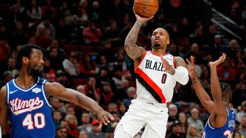 <p>               FILE - In this Saturday, March 7, 2020, file photo, Portland Trail Blazers guard Damian Lillard, center, shoots as Sacramento Kings forward Harrison Barnes, left, and forward Harry Giles III, right, defend during the first half of an NBA basketball game in Portland, Ore. Lillard says he will spend most of his downtime working on recording music while inside the NBA bubble. (AP Photo/Steve Dipaola, File)             </p>