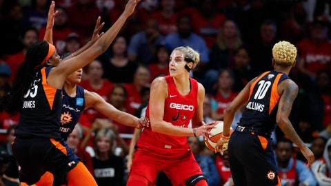 <p>               FILE - In this Oct. 10, 2019, file photo, Connecticut Sun forward Jonquel Jones, left, and guard Courtney Williams, right, huard Washington Mystics forward Elena Delle Donne during the first half of Game 5 of basketball's WNBA Finals in Washington. Delle Donne is waiting to have her case heard by the league's independent panel of doctors to see if she'll be medically excused for the season, according to the Mystics. The Mystics star, who was the league Most Valuable Player last year, has battled Lyme Disease since 2008 and would potentially be at a higher risk for serious illness if she contracted the new coronavirus. (AP Photo/Alex Brandon, File)             </p>