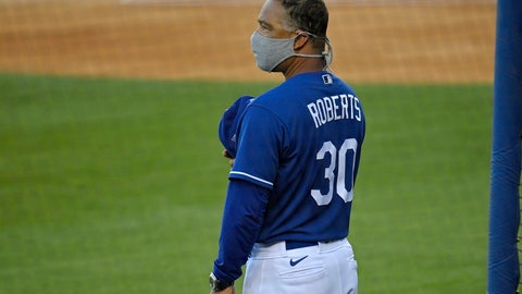 <p>               Los Angeles Dodgers manager Dave Roberts stands for the national anthem prior to an intrasquad game during baseball training Monday, July 6, 2020, in Los Angeles. (AP Photo/Mark J. Terrill)             </p>