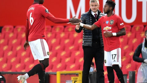 <p>               Manchester United's Paul Pogba, left, gestures to teammate Fred as he is substituted during the English Premier League soccer match between Manchester United and Southampton at Old Trafford in Manchester, England, Monday, July 13, 2020. (AP Photo/Dave Thompson,Pool)             </p>