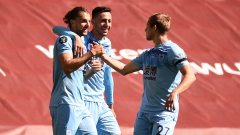<p>               Burnley's Jay Rodriguez, left celebrates with teammates after scoring his sides first goal during the English Premier League soccer match between Liverpool and Burnley at Anfield, Liverpool, England, Saturday, July 11, 2020. (Oli Scarff/ Pool via AP)             </p>
