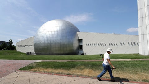 <p>               A worker carries a shovel in front of the Naismith Memorial Basketball Hall of Fame in Springfield, Mass., Tuesday, June 23, 3030. The museum is scheduled to reopen in the beginning of July 2020 with a whole new look after a $22 million renovation. (AP Photo/Steven Senne)             </p>