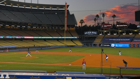 <p>               The Los Angeles Dodgers play the Los Angeles Angels at sunset during the fifth inning of a preseason baseball game, Tuesday, July 21, 2020, in Los Angeles. (AP Photo/Mark J. Terrill)             </p>