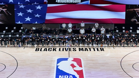 <p>               Members of the New Orleans Pelicans and Utah Jazz kneel together around the Black Lives Matter logo on the court during the national anthem before the start of an NBA basketball game Thursday, July 30, 2020, in Lake Buena Vista, Fla. (AP Photo/Ashley Landis, Pool)             </p>