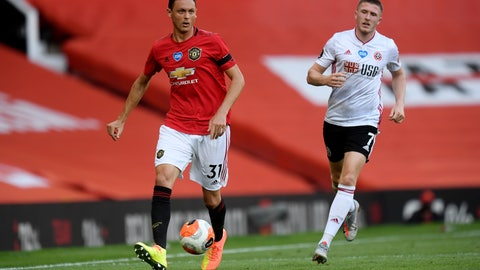 <p>               Manchester United's Nemanja Matic, left, passes the ball during the English Premier League soccer match between Manchester United and Sheffield United at Old Trafford in Manchester, England, Wednesday, June 24, 2020. (Michael Regan/Pool via AP)             </p>
