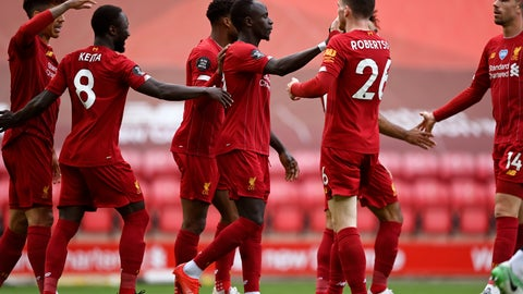 <p>               Liverpool's Sadio Mane, center, celebrates after scoring the opening goal during the English Premier League soccer match between Liverpool and Aston Villa at Anfield Stadium in Liverpool, England, Sunday, July 5, 2020. (Shaun Botterill/Pool via AP)             </p>