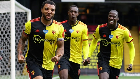 <p>               Watford's Troy Deeney, left, celebrates with teammates after scores his side's second goal from the penalty spot during the English Premier League soccer match between Watford and Newcastle at the Vicarage Road Stadium in Watford, England, Saturday, July 11, 2020. (Richard Heathcote/Pool via AP)             </p>