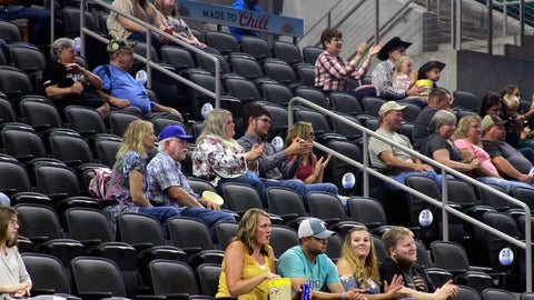 <p>               Some of a little more than a thousand fans are on hand in a 9,000-seat arena in Sioux Falls, S.D., Friday, July 10, 2020, to watch one of the first indoor professional sporting events since the coronavirus pandemic began. (AP Photo/Stephen Groves)             </p>
