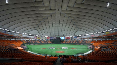 <p>               FILE - In this June 19, 2020, file photo, players gather in the empty stands prior to a baseball game between the Yomiuri Giants and the Hanshin Tigers at the Tokyo Dome in Tokyo. Japan's professional baseball and soccer leagues will begin allowing fans this week, the head of both leagues said on Monday, July 6, 2020. (AP Photo/Eugene Hoshiko, File)             </p>