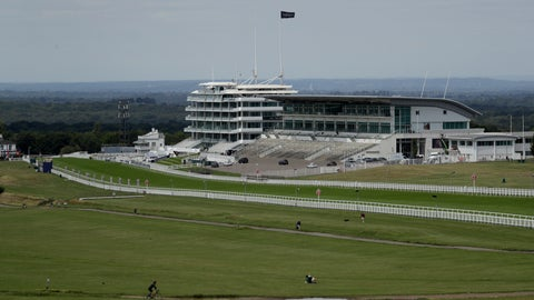 <p>               People cycle, walk and sit on the Downs surrounded by the Epsom Downs Racecourse, in Epsom, England, Friday, July 3, 2020. The Derby annual horse race will take place at the Epsom Downs Racecourse behind closed doors on Saturday amid the coronavirus pandemic. (AP Photo/Matt Dunham)             </p>