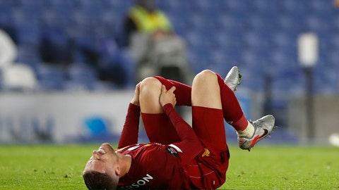 <p>               Liverpool's Jordan Henderson reacts during the English Premier League soccer match between Brighton and Liverpool at Falmer Stadium in Brighton, England, Wednesday, July 8, 2020. (AP Photo/Paul Childs,Pool)             </p>