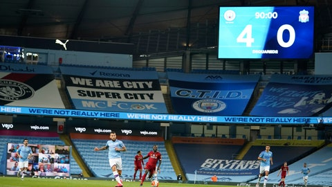 <p>               Scoreboard shows the final score during the English Premier League soccer match between Manchester City and Liverpool at Etihad Stadium in Manchester, England, Thursday, July 2, 2020. (AP Photo/Dave Thompson,Pool)             </p>