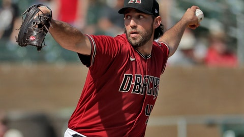 <p>               FILE - In this Feb. 27, 2020, file photo, Arizona Diamondbacks pitcher Madison Bumgarner throws during the second inning of spring training baseball game against the Cincinnati Reds in Scottsdale Ariz. Arizona's new pitching addition Bumgarner threw two innings of live batting practice on Saturday, July 4, 2020. It was his first outing during the team's summer camp at Chase Field as the D-backs prepare for a 60-game season. (AP Photo/Matt York, File)             </p>