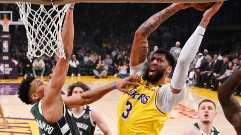 <p>               FILE - In this March 6, 2020, file photo, Los Angeles Lakers forward Anthony Davis, right, shoots as Milwaukee Bucks forward Giannis Antetokounmpo defends during the first half of an NBA basketball game in Los Angeles. Davis and the Lakers were leading the Western Conference when the coronavirus pandemic caused the suspension of the NBA season, but he is confident they'll be able to resume their title chase. (AP Photo/Mark J. Terrill, File)             </p>