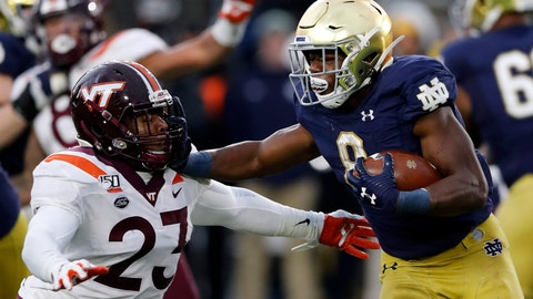 <p>               FILE - In this Nov. 2, 2019, file photo, Notre Dame running back Jafar Armstrong (8) stiff arms Virginia Tech linebacker Rayshard Ashby (23) during the second half of an NCAA college football game in South Bend, Ind. The Atlantic Coast Conference and Notre Dame are considering whether the Fighting Irish will give up their treasured football independence for the 2020 season play as a member of the league. (AP Photo/Carlos Osorio, File)             </p>